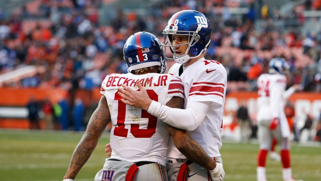 New York Giants wide receiver Odell Beckham Jr. (13) celebrating his touchdown catch with quarterback Eli Manning (10) in the second half of Sunday's game.