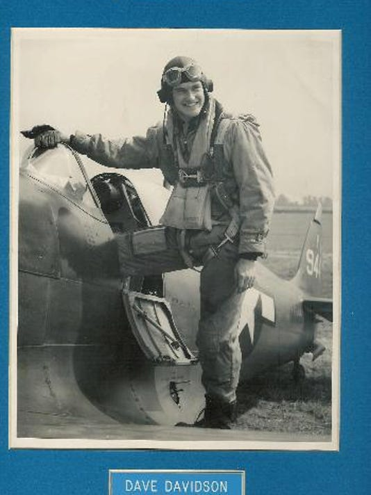 Lt. Verner 'Dave' Davidson next to British Spitfire plane.jpg
