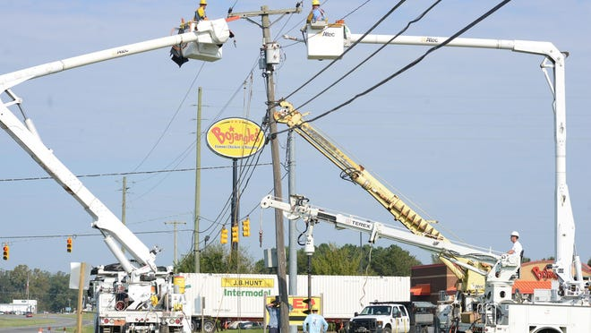 Kinston Public Services lineman repair a utility pole. Municipal utilities in North Carolina would like Gov. Roy Cooper to cancel an executive order that has prohibited them from efforts to seek delinquent payments from residential customers during the coronavirus pandemic.