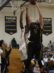 Clarksville High's Devyn Bender (15) goes up for the
