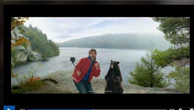 An I Love New York tourism ad depicting a bear selfie.