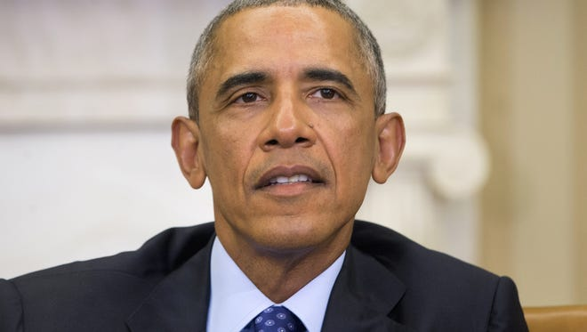 President Barack Obama speaks in the Oval Office of the White House in Washington on Monday during a meeting with law enforcement officials to discuss executive actions the president can take to curb gun violence.