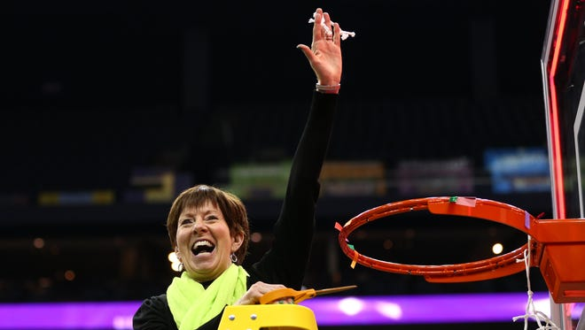 Notre Dame Fighting Irish coach Muffet McGraw reacts after cutting down part of the net after defeating the Mississippi State Lady Bulldogs in the championship game of the women's Final Four in the 2018 NCAA Tournament at Nationwide Arena. Notre Dame won 61-58.