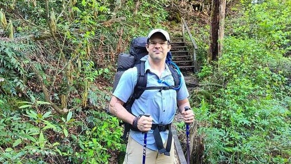 Brett Smith is pictured hiking, which is a favorite pasttime for the Williston native.