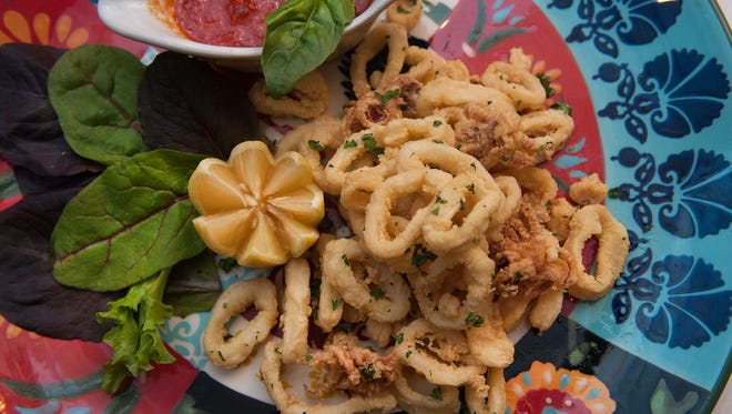 Calamari with marinara sauce is presented at Nunzio Ristorante Rustico in Collingswood. The restaurant is among at least eight Italian eateries in the borough.