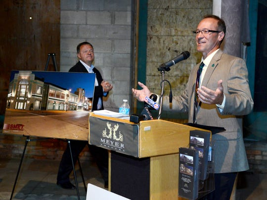 Meyer Theatre board president Jeff Mirkes, right, introduces Doug Mueller, president of Breakthrough Fuel, during Friday's groundbreaking ceremony for the expansion project, Backstage at the Meyer. Breakthrough Fuel will occupy the second floor of the building.