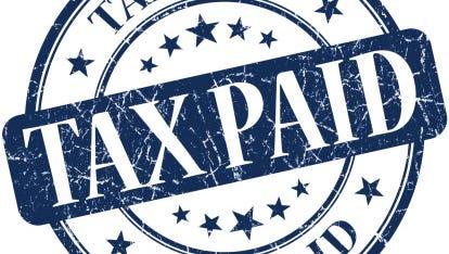 Tax paid grunge round blue stamp