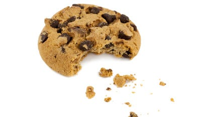 Chocolate chip cookie with bite taken out