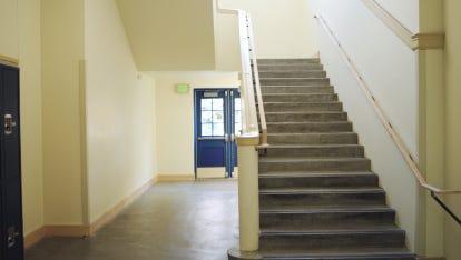 High school interior, empty stairway
