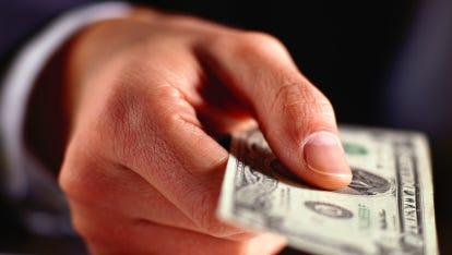 Hand Holding a Twenty Dollar Bill