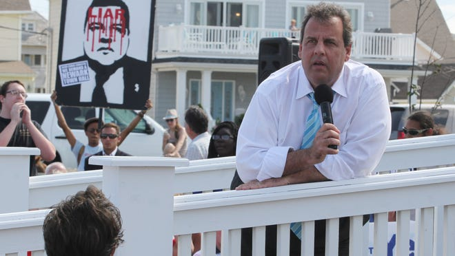 Governor Chris Christie talks to crowd at the Huisman Gazebo  in Belmar during town hall meeting.  Wednesday July 30 Belmar NJ.   Photo by Robert Ward