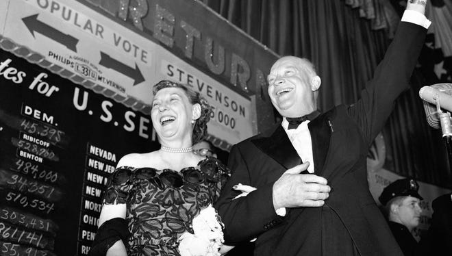Dwight D. Eisenhower and his wife, Mamie, greet a New York City crowd on Nov. 4, 1952, the night he was elected U.S. president.