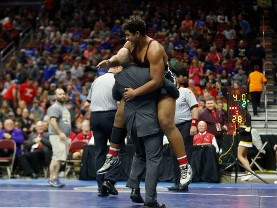 Mount Vernon's Tristan Wirfs celebrates his win in the class 2A, 220-pound title match Saturday, Feb. 18, 2017 in the state wrestling finals at Wells Fargo Arena in Des Moines.