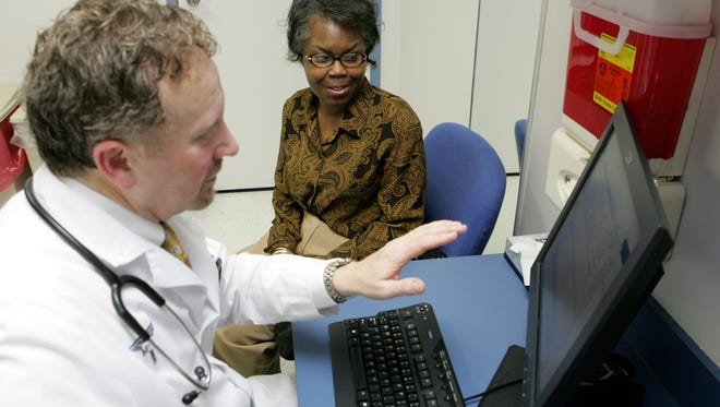 Dr. Peter Basch of Washington, D.C., enters health information from Clara Jackson into an electronic medical record file. Basch has used electronic records for 12 years. The Obama administration is promoting the use of electronic medical records.