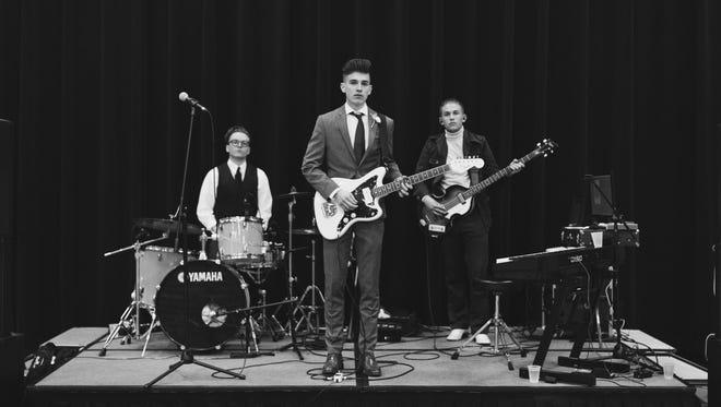 Isaac Hesse, left, Grant Hamilton, center, and Eddie Hamilton form the band Guytano.