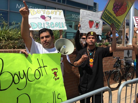 "Salinas City Councilman José Castañeda, left, and a man who identified himself only as ""Michael,"" right, were among 11 protestors who tried to disrupt the Forbes AgTech summit Thursday afternoon in downtown Salinas."