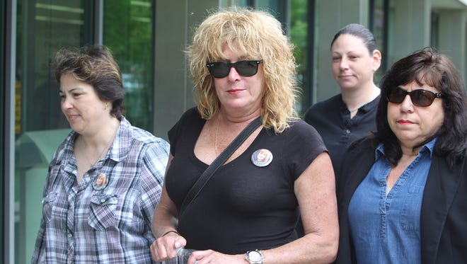 Peggy Nadell's daughter, Susanne Nadell-Scaccio, enters Rockland County Courthouse on Tuesday, May 12, 2015.