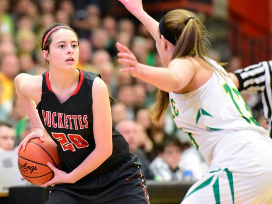 Buckeye Central's Haley Green, left, eyes the basket past Ottoville's Bridget Landin during the Division IV regional semifinal in Elida.