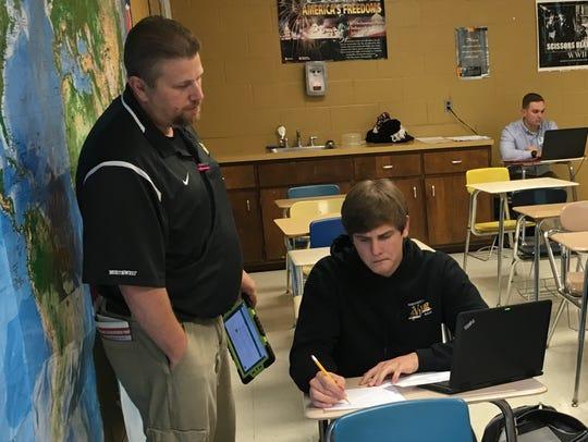 Northwest High School teacher Jeffery Lamb talks with