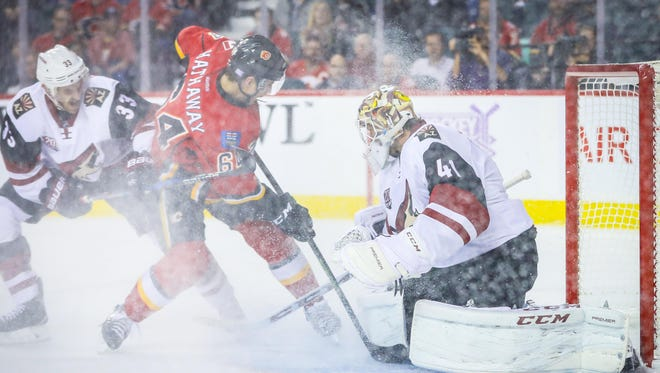 Arizona Coyotes goalie Mike Smith (41) makes a save as Calgary Flames right wing Garnet Hathaway (64) tries to score during the first period at Scotiabank Saddledome.