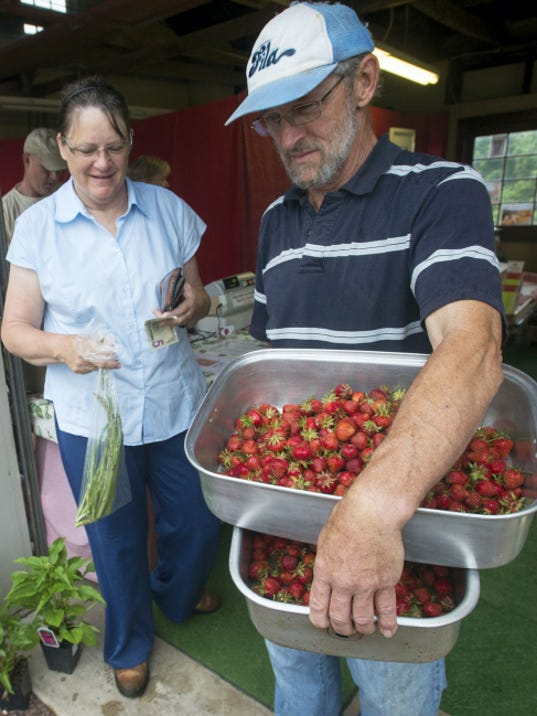 Jennie and Bob Heiner, of Dover Township, brought their own containers to Barefoot Farm to bring home strawberries. Bob Heiner makes strawberry pies.