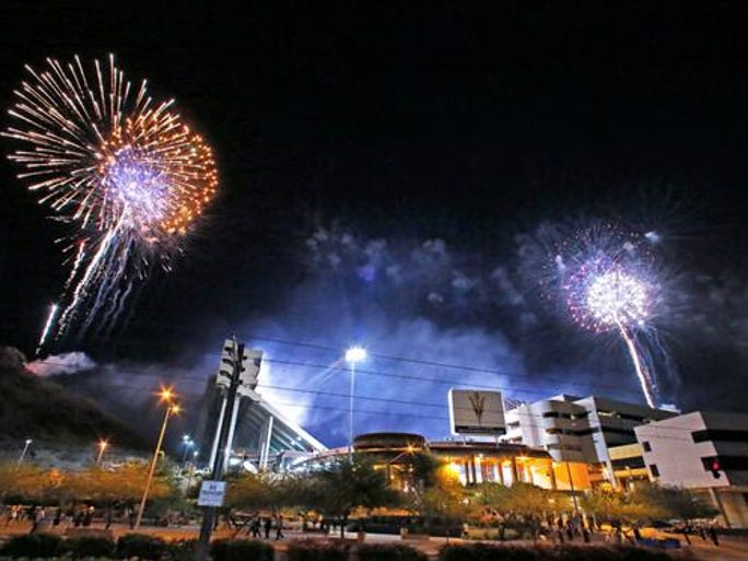 #AzGrads Fireworks explode over Sun Devil Stadium following the Arizona State University 2014 spring graduation.