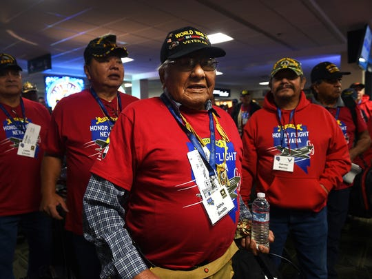 WWII veteran John Smith, middle, poses for a portrait with other Native American veterans as they prepare to board an Honor Flight airplane bound for Washington D.C. at the Reno-Tahoe International Airport in Reno on Nov. 10, 2016.