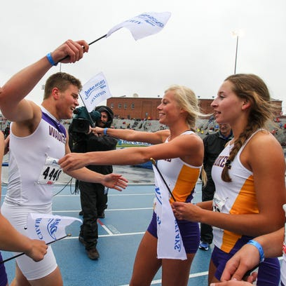 Waukee's Patrick Gray celebrates with the winning girls'