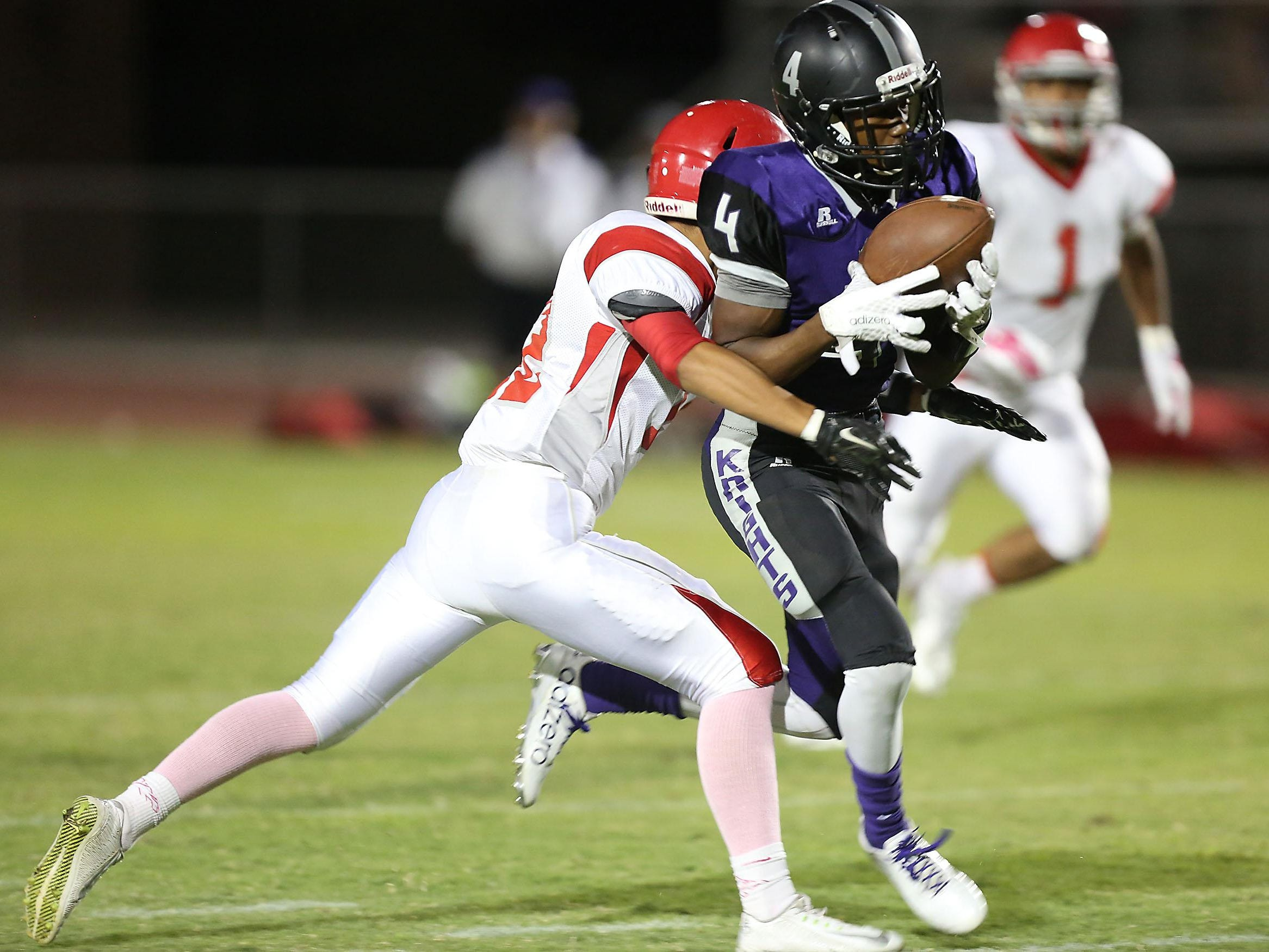 Shadow Hills reciever Derwin Johnson catches a pass for the first touchdown of the game against Desert Mirage, Friday, October 2, 2015.