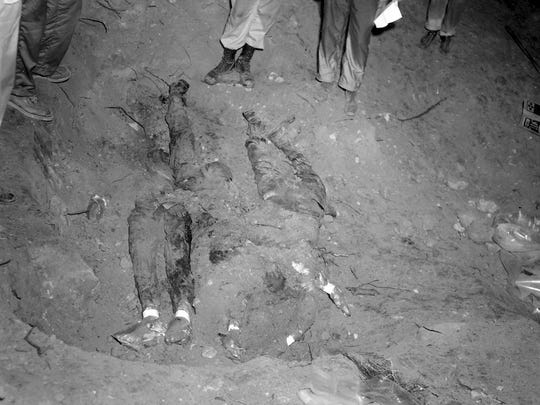 In this 1964 file photo released by the FBI, the bodies