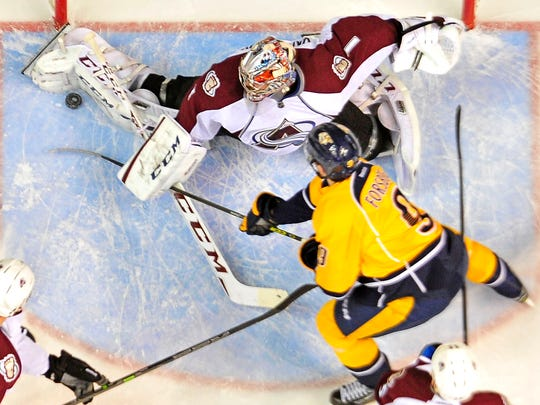Avalanche goalie Semyon Varlamov saves a shot by Predators Filip Forsberg on Feb. 24.