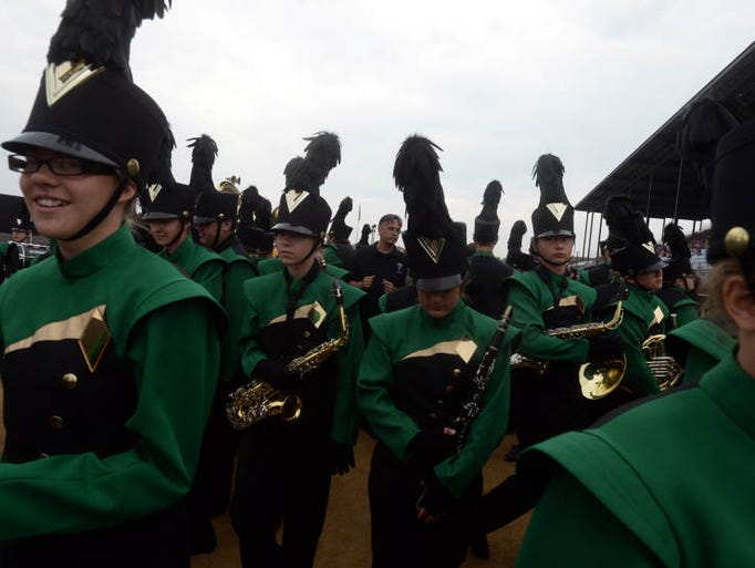 Members of the Northeastern High School band under the direction of Dan Merkamp, center, prepare to perform during Band Day at the Indiana State Fair Saturday, Aug. 2, 2014.