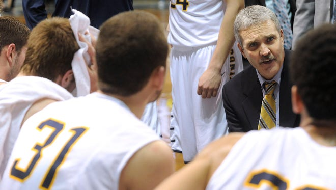 Augustana's head coach Tom Billeter talks with his team during a timeout against University of Minnesota Duluth during the NSIC tournament at the Pentagon in Sioux Falls, SD, Sunday, March 1, 2015.