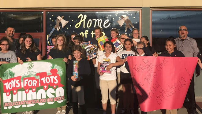 Ruidoso Middle School cheerleaders go all out for Toys for Tots.