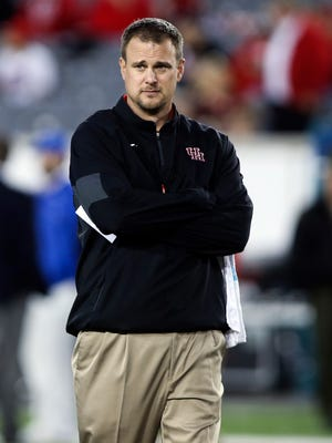 Houston Cougars head coach Tom Herman watches during practice before a game against the Memphis Tigers at TDECU Stadium.