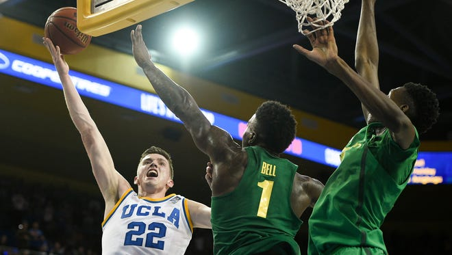 UCLA forward TJ Leaf attempts a shot defended by a pair of Oregon defenders during their game last week.