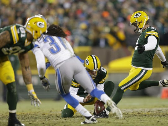 Green Bay Packers kicker Mason Crosby has his field goal attempt blocked in the fourth quarter Dec. 28, 2014 against the Detroit Lions at Lambeau Field.