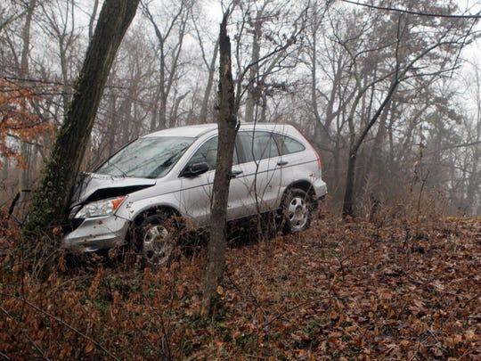 A Honda CRV slid off the end of Burnet Woods Drive