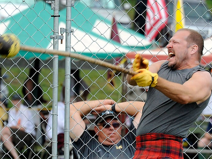 The 59th annual Grandfather Mountain Highland Games and gathering of Scottish clans at MacRae Meadows. Johnny Reed struggles to throw the 22 pound hammer during class B Scottish athletic competition Friday.  The greatest distance throw is the winner in this event.  07/11/14