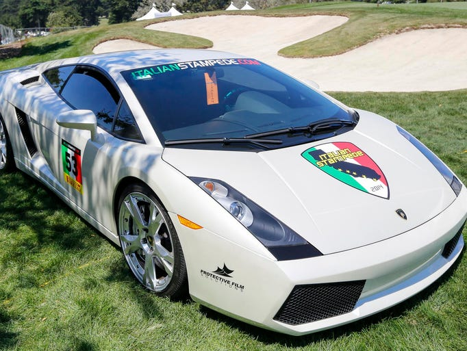 A Lamborghini Gallardo is showcased on the golf course during the 2014 Concorso Italiano at Black Horse Golf Course, Saturday, August 16, 2014 in Seaside, Calif.