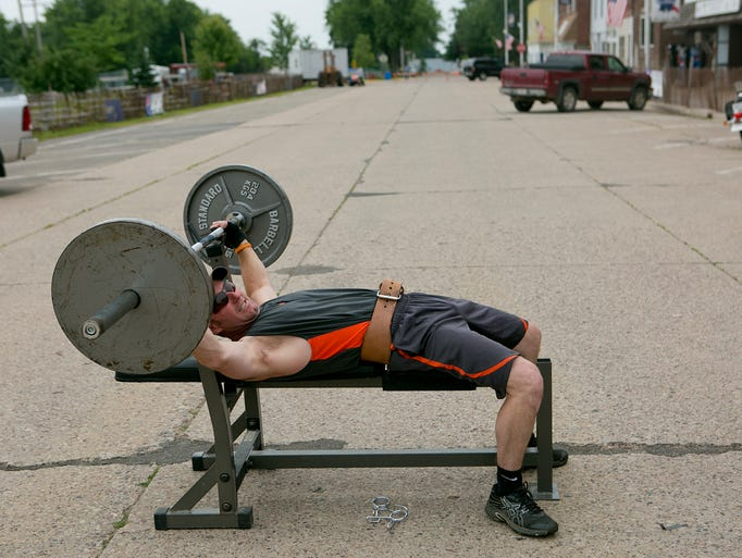 Craig Stuttgen of Colby warms up for the bench press competition during Colby Cheese Days, Saturday, July 19, 2014. The bench press competition benefitted the Highground Veterans Memorial Park.