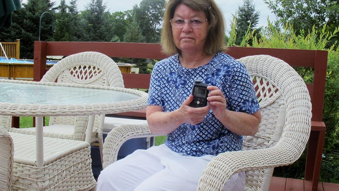 Jean Grady holds her insulin pump, which helps manage her diabetes, at her home in Westford, Vermont. Before the pandemic, Medicare rules required her make regular two-hour, one-way trips to New Hampshire to meet with her doctor to discuss her treatment. Medicare rule changes during the pandemic now makes it possible for her to meet with her doctor remotely, saving her from hours on the road.