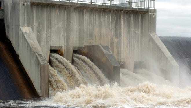 File: Water rushes through Union Lake Dam on  Wednesday, April 18, 2007 during the third day of flooding in Cumberland County.