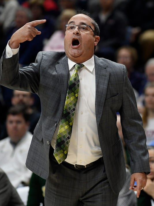 South Florida head coach Jose Fernandez calls to his team during the first half an NCAA college basketball game against Connecticut, Monday, Feb. 26, 2018, in Storrs, Conn. (AP Photo/Jessica Hill)