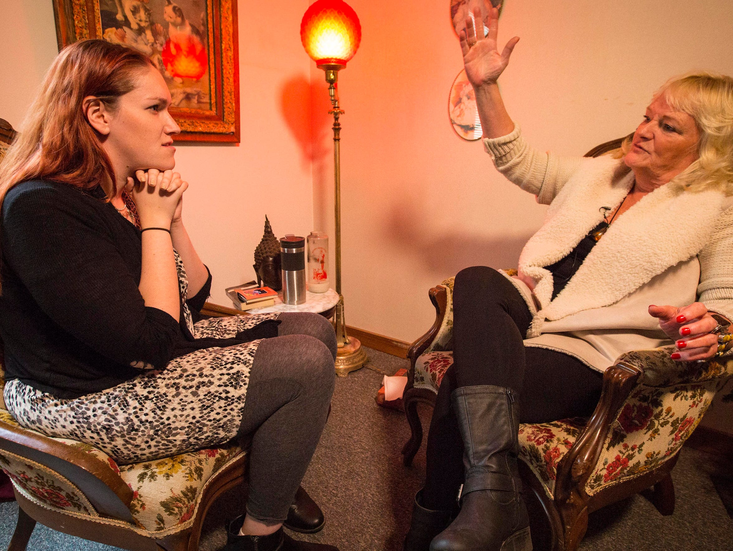 Life Coach Janine Ambrose, right, talks with Register