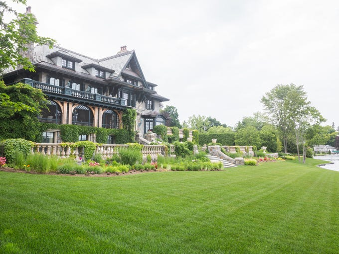 The lakeside home is Victorian in style, with bluestone
