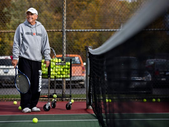 Coach Dave Fredette watches over players during tennis practice Tuesday, October 13, 2015 at Armada High School. Fredette has coached the Armada High School boys tennis team for 50 years.