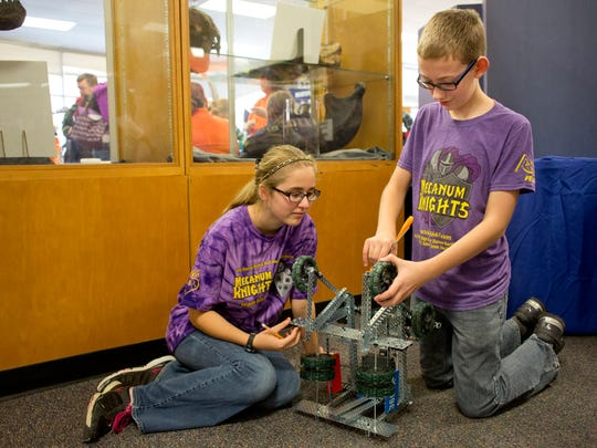 Mecanum Knights members Addie Hughes and Nolan Odom, both 13, work on a robot during a STEM conference Saturday, October 24, 2015 in the Clara E. Mackenzie building on the campus of St. Clair County Community College.
