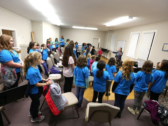 The Vivace and Dolce choirs of Willamette Girlchoir rehearse together at First United Methodist Church in downtown Salem.
