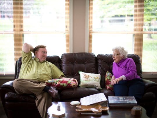 Michael talks with his mother, Mary, in her living room. Mary grew up in Hungary during World War II and watched neighbors die in the streets. She emerged from the war with a strong faith and passed it on to her children.